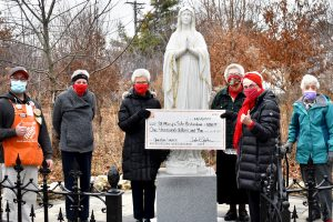 Photo of check and Blessed Virgin Mary statue
