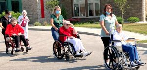 Sisters in wheelchairs headed to Sacred Heart statue
